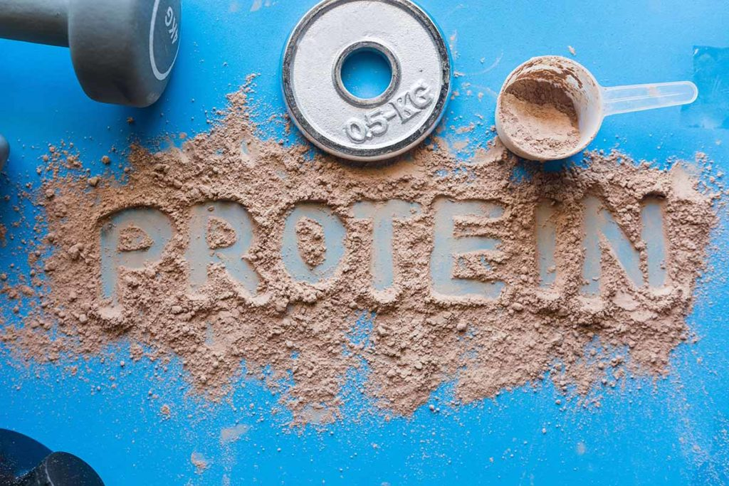 the word protein spelled out in protein shake powder