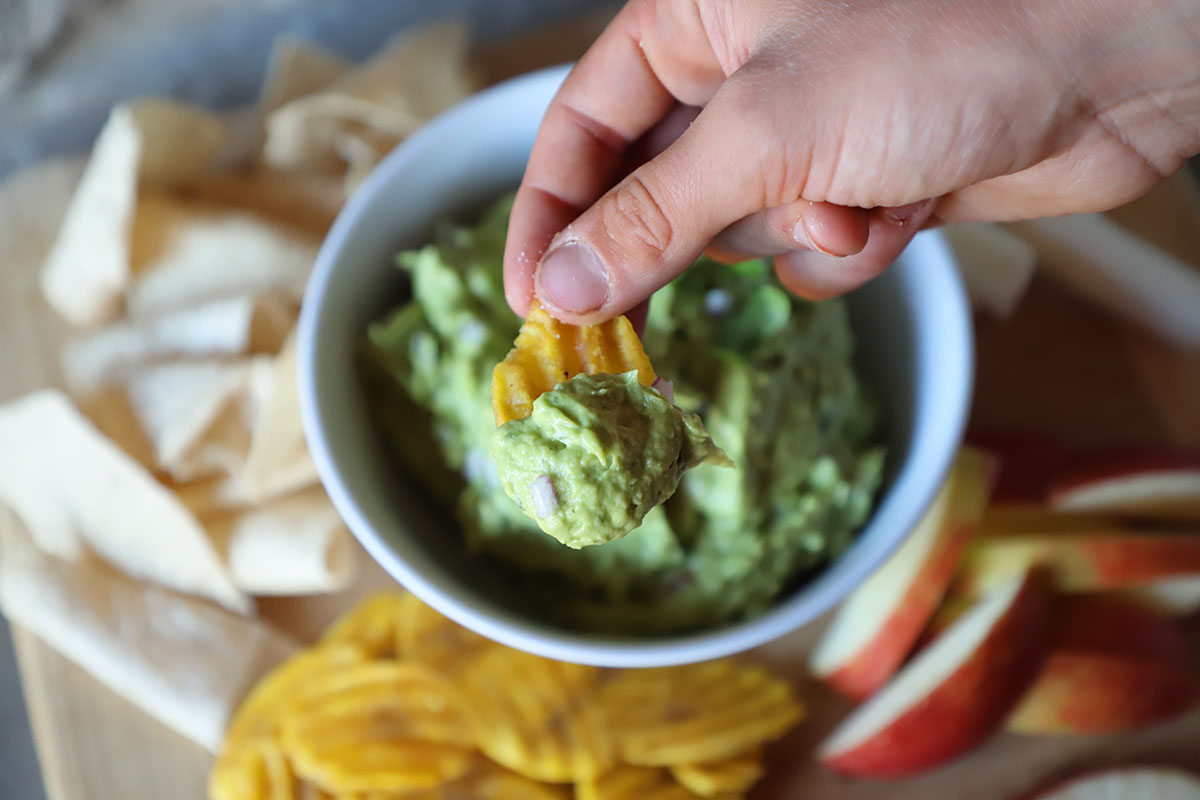 dipping-chips-in-guacamole